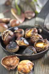 Frying pan with roasted chestnuts.