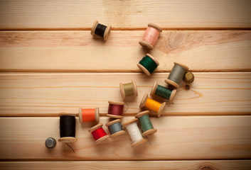 Sewing kit. Scissors, bobbins with thread and needles on the old
