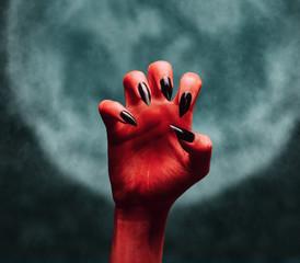 Devil hand at midnight