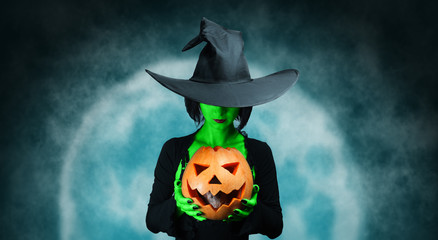 Mystery witch with pumpkin