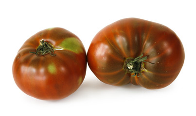 two tomatoes on white background
