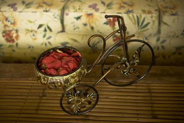 still life with mini bicycle on wooden background