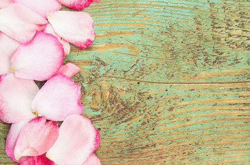 Rose petal over wooden background