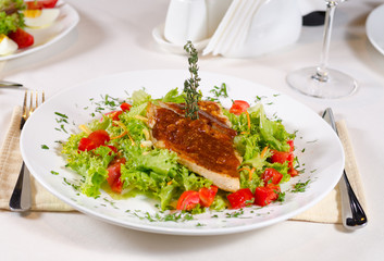 Delicious Recipe on Frisee Lettuce on White Plate