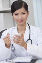 Chinese Female Woman Doctor Drinking Coffee or Tea