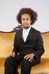 Handsome Black man sitting and smiling