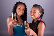 Young beautiful African womans holding a glass of champagne - 71511248
