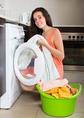 Girl using washing machine at home