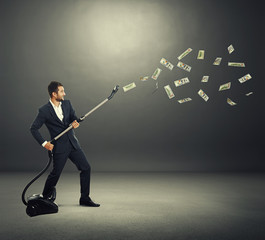 man catching paper money