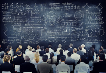 Multiethnic People with Formula on Chalkboard
