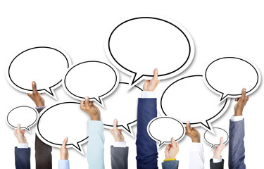 Group of Business Hands Holding Speech Bubbles
