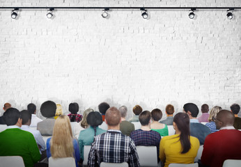 Group of Diverse People Facing White Brick Wall