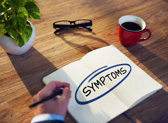 "Businessman Writing the Word ""Symptoms"""