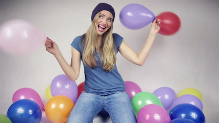 Happy beautiful girl with baloons looking at camera
