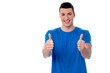 Young smiling man showing thumbs up