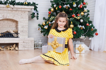 Portrait of the girl with the packaged gift
