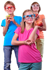 Group of children with apples wearing eyeglasses