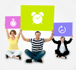 Smiling people holding board in clock symbol