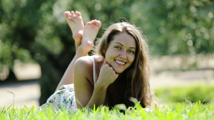 girl laying outdoor in grass meadow