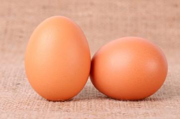 Egg on sackcloth background