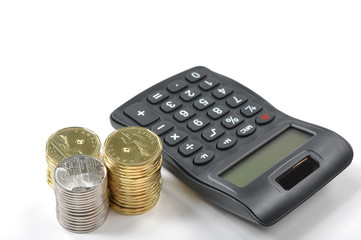 A calculator and money isolated on a white background