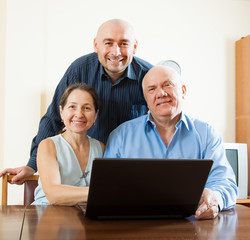 men and woman at home with laptop