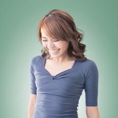 Shy Asian girl smiling