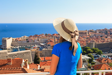 young woman looking at Dubrovnik, Croatia