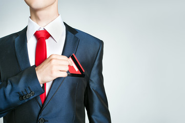 Businessman getting out credit card of the pocket