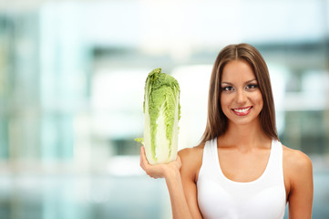 Shopping concept. Beautiful young woman with cabbage