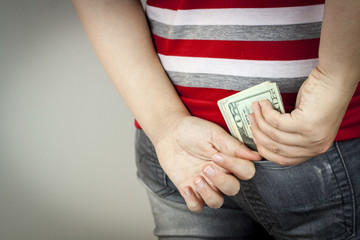 Teenage girl with US dollars
