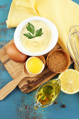 Mayonnaise ingredients on wooden background