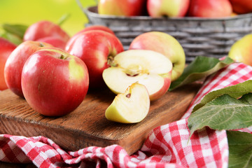 Sweet apples  on table on bright background