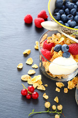 fresh ripe berries and granola in a glass