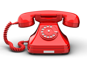 An old fashioned antique rotary style telephone isolated over a