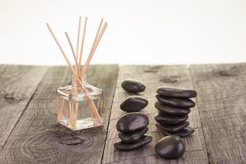 Aromatherapy sticks and black stones close-up