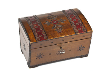 old scratched wooden casket with an ornament on a white backgrou