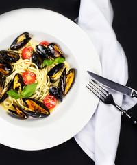 Gourmet Shellfish with fresh italian pasta, cherry tomato and he