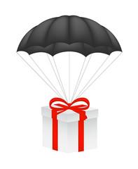 Gift box at black parachute