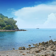 Small lagoon and sailboat on the horizon