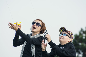 Mother and son venturing kite