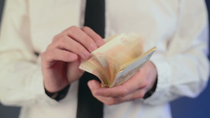 Businessman counting 50 euro banknotes money