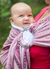 Woman with infant in sling