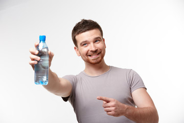 man in jeans and a T-shirt with bottle of water