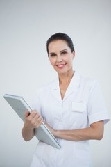 Smiling doctor holding a laptop