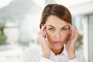 Businesswoman with headache in office