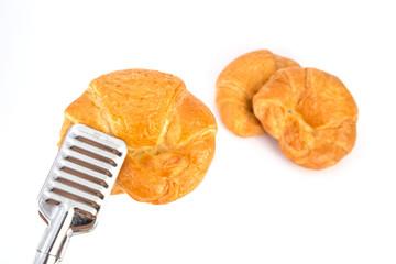 Fresh croissant over white background