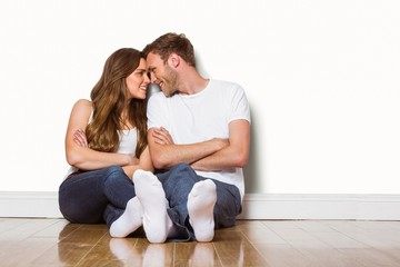 Romantic couple sitting on floor