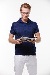 man in jeans and a blue shirt with magazine