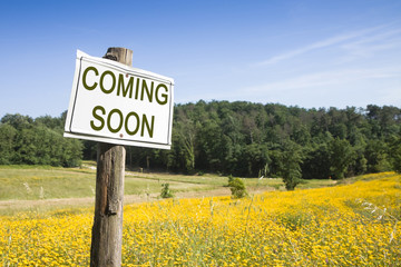 Coming Soon concept - Coming Soon concept written on a field sig